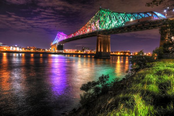 Colorful Jacques Cartier Bridge in Montreal City during Covid 19 - RF Stock Photo